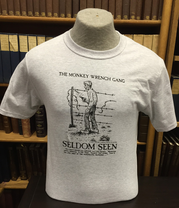Seldom Seen Smith T-Shirt (Fence) - Ash (M); The Monkey Wrench Gang T-Shirt Series. Edward Abbey/R. Crumb.