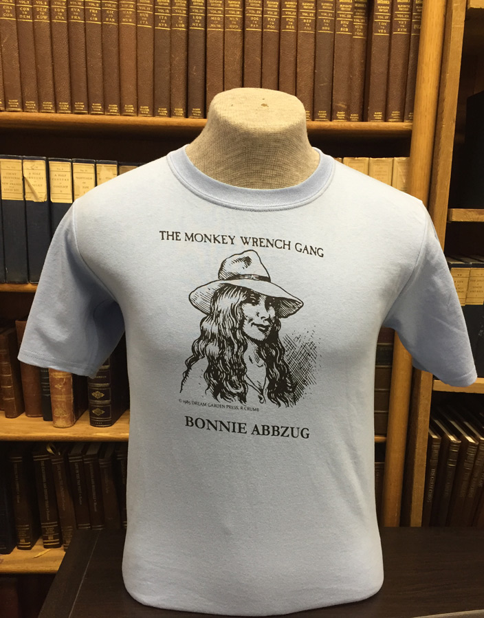 Bonnie Abbzug T-Shirt - Light Blue (M); The Monkey Wrench Gang T-Shirt Series. Edward Abbey/R. Crumb.