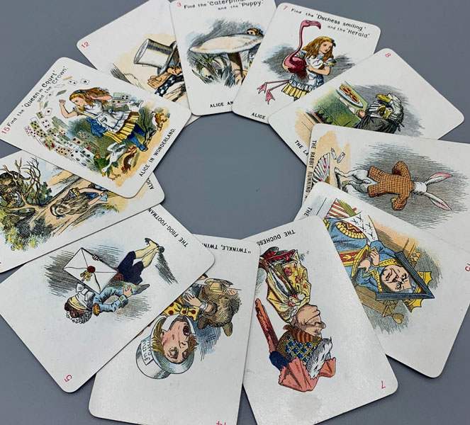 The New and Diverting Game of Alice in Wonderland consisting of Forty-Eight Pictorial Cards Depicting the most famous characters and scenes in the above work. Adapted, drawn in fac-simile, and elaborately rendered in colours. From Sir John Tenniel's Original Designs By Miss E. Gertrude Thomson [Deck of Cards]. Card Came, E. Gertrude Thomson, Lewis Carroll, Charles Lutwidge Dodgson.
