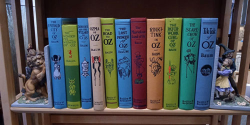 Oz Facsimile First Editions (11 Volumes) with two bookends and a figurine of the Wicked Witch. L. Frank Baum.