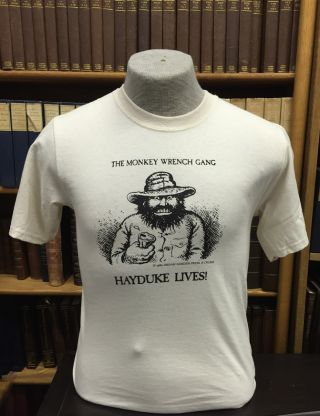 Hayduke Lives! T-Shirt - Natural (L); The Monkey Wrench Gang T-Shirt Series. Edward Abbey/R. Crumb.