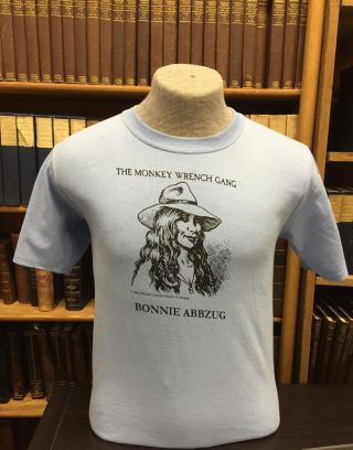 Bonnie Abbzug T-Shirt - Light Blue (L); The Monkey Wrench Gang T-Shirt Series. Edward Abbey/R. Crumb