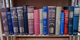 Facsimile First Editions (15 Volumes) with two bookends and Mark Twain Sculpture. Mark Twain